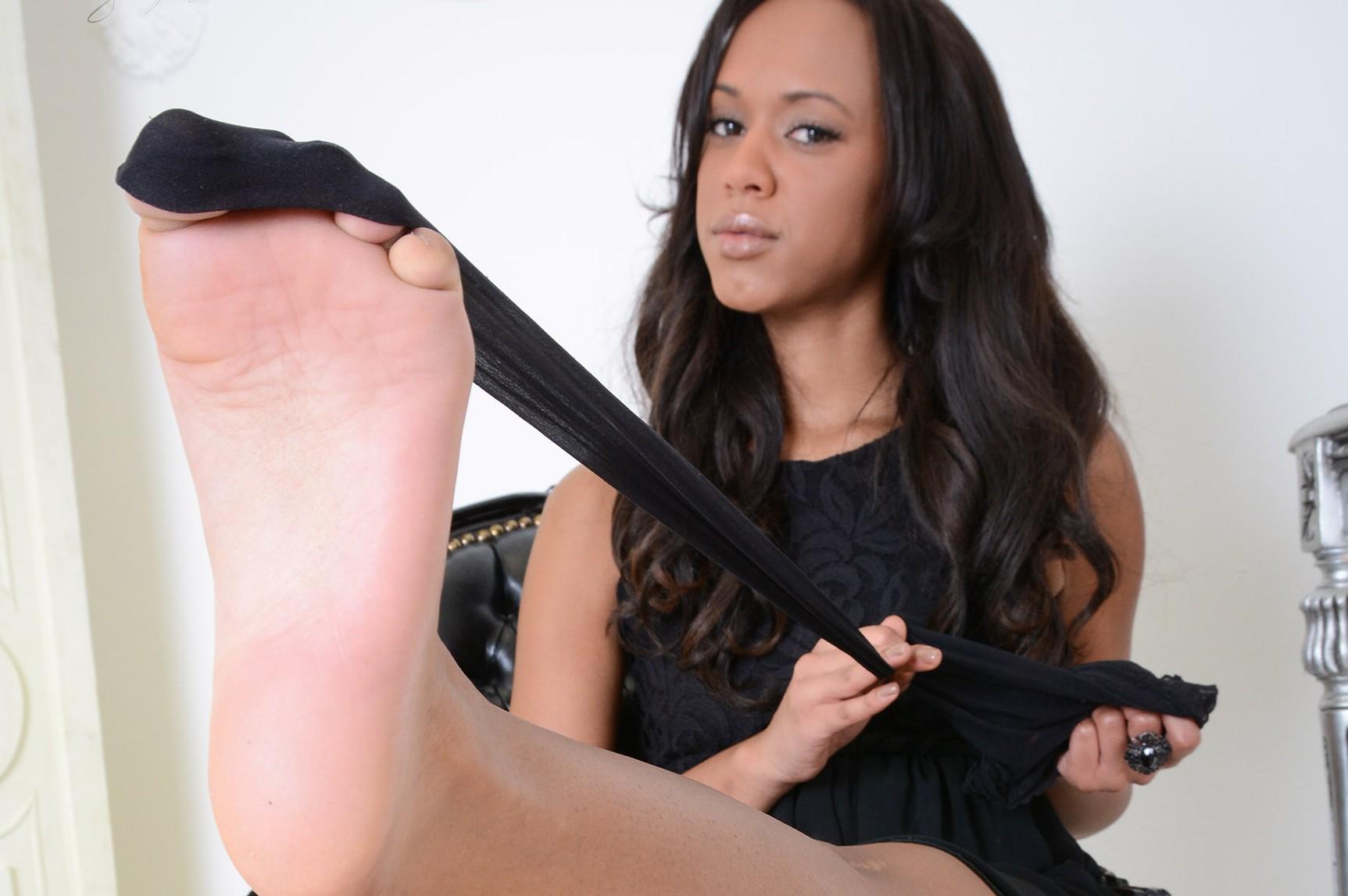 Schöne Beine und zarte Füße